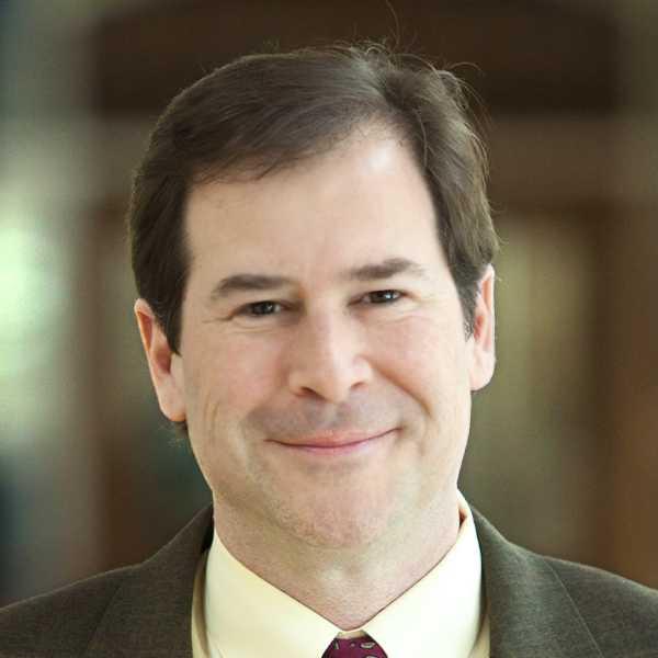 Headshot of Mark Gesner